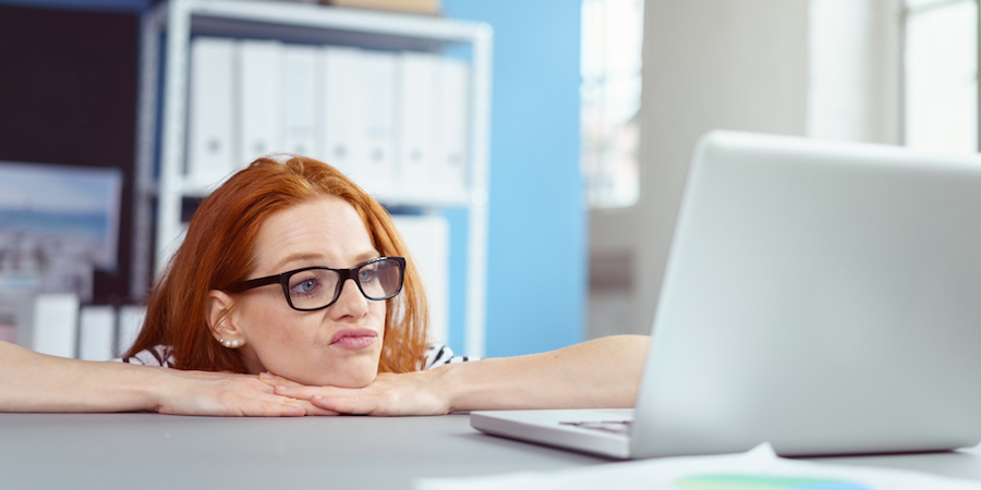 girl looking at her computer