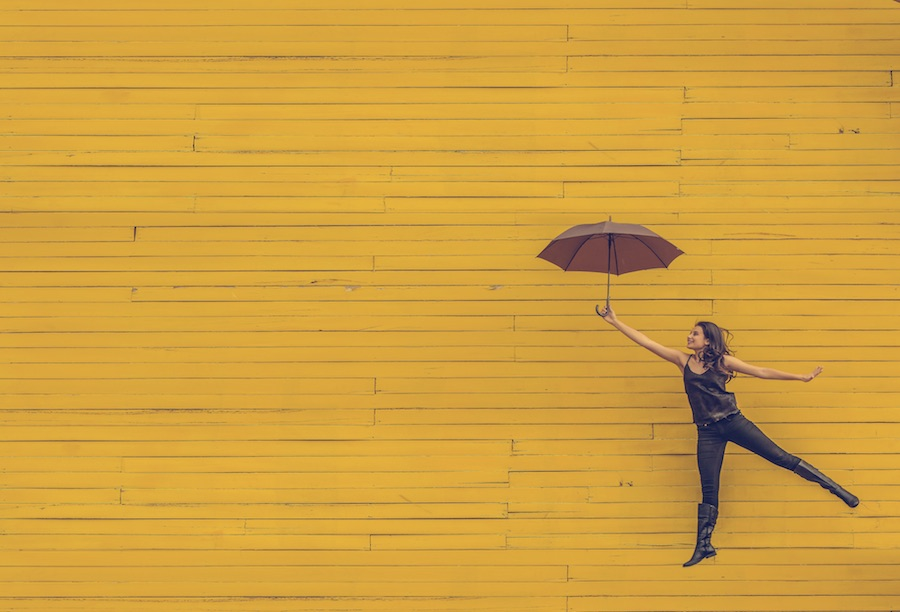girl floating with an umbrella
