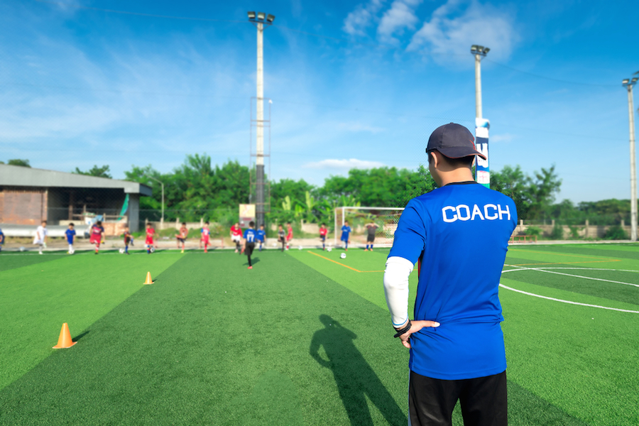 a coach working to improve employee evaluations